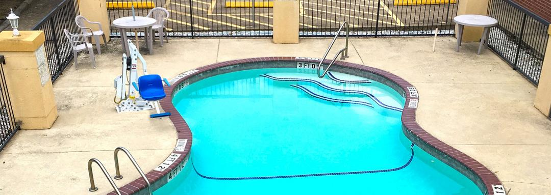 Outdoor pool area with ADA lift chair