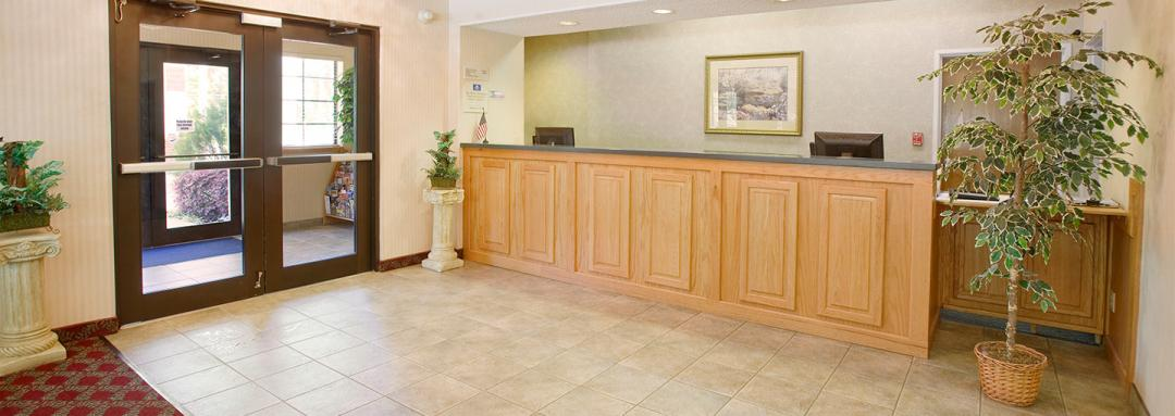 Hotel lobby and front desk with artwork and plants
