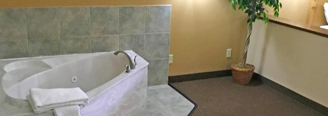 In-room Jacuzzi tub with towels