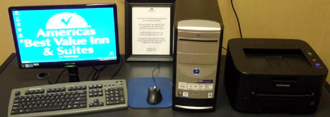 Hotel business center with computer and printer