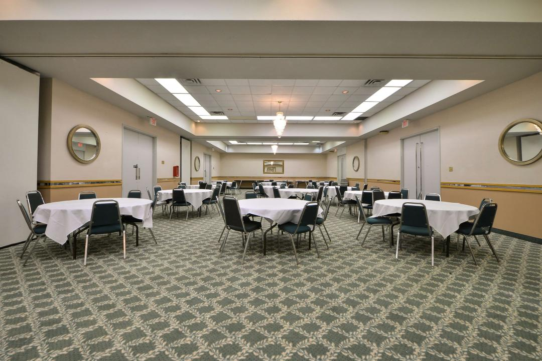 Meeting space with multiple tables and chairs
