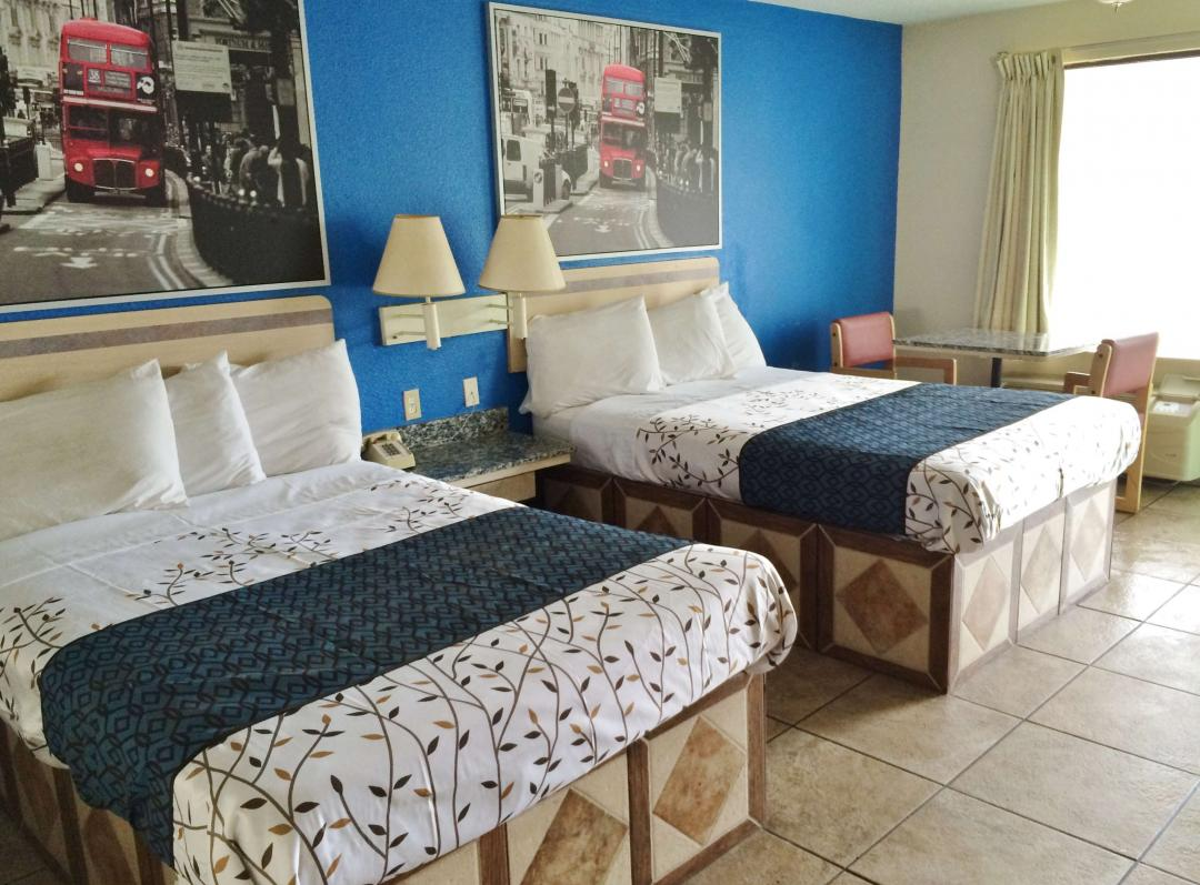Two bed guest room with tile floors
