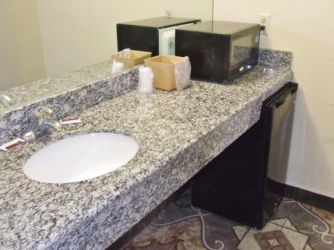 Guestroom amenties include microwave and refrigerator