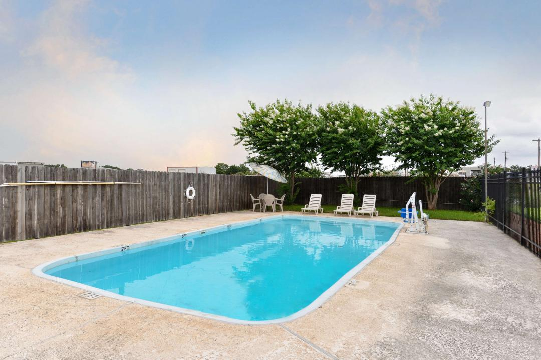 Outdoor Gated Pool with Accessible Chair and Seating
