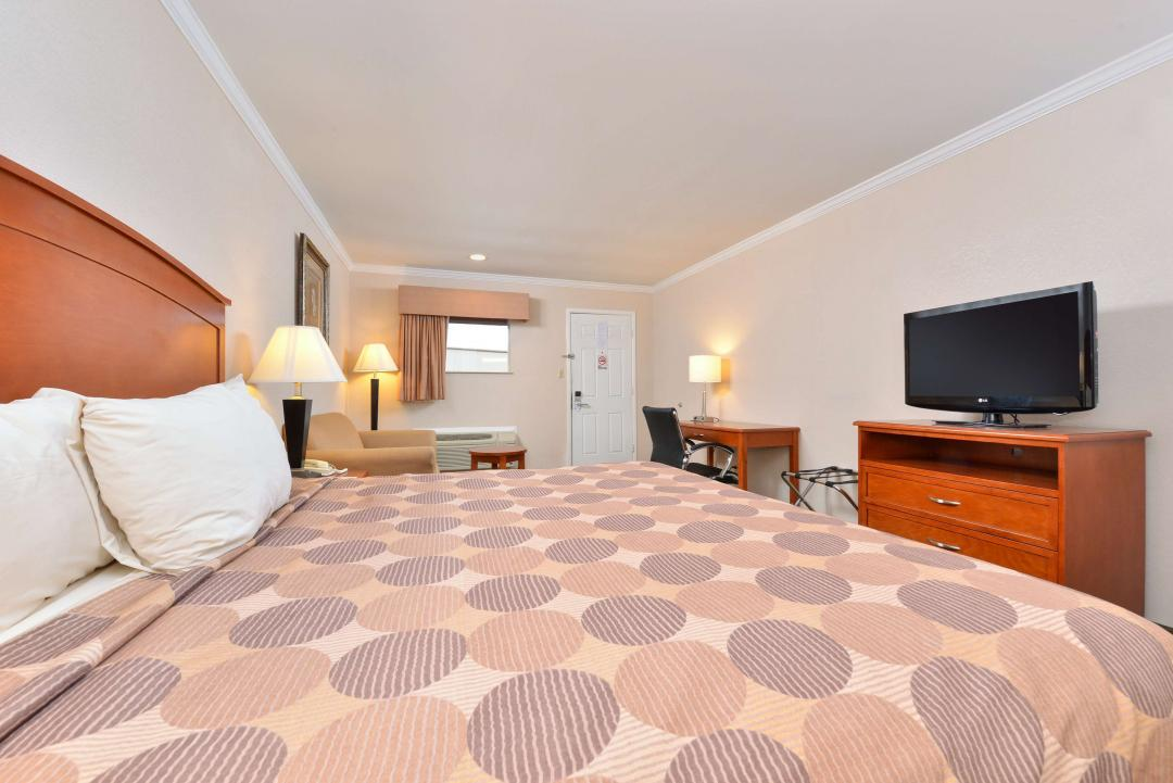 Spacious One King Bed with TV, Armchair, Desk
