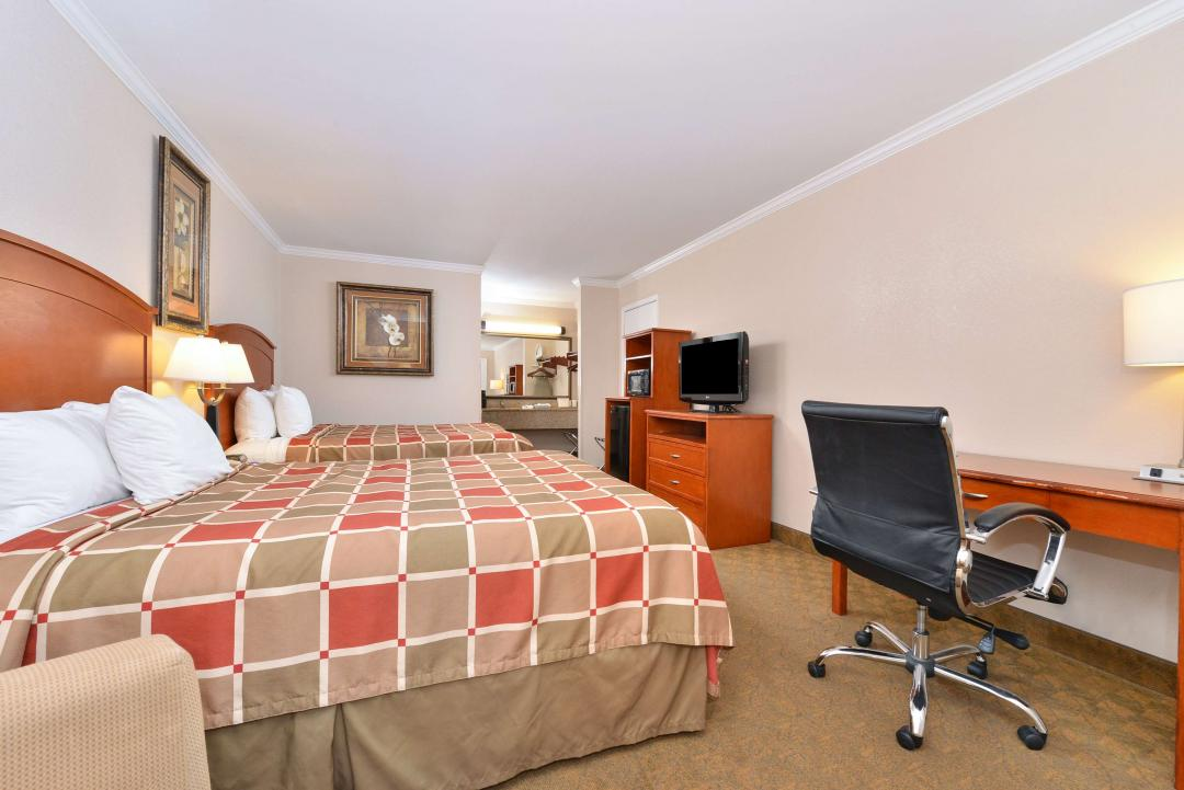 Guest room with two queen beds and desk