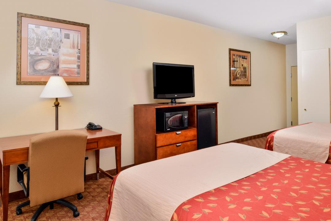 Spacious two queen guest room with desk and flatscreen TV