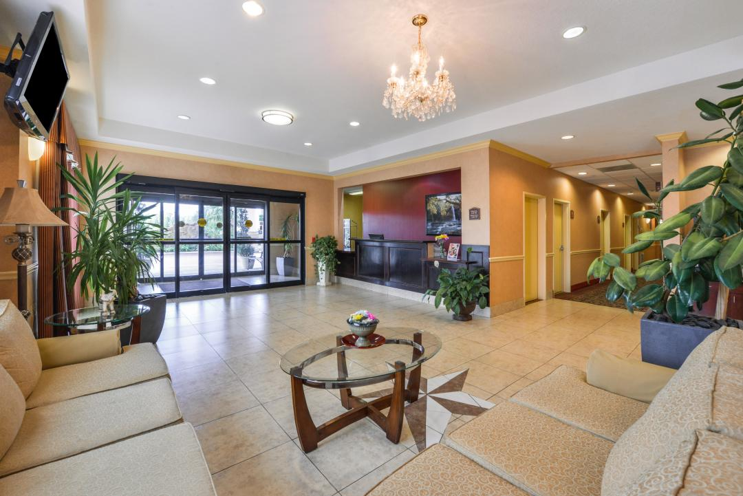 Spacious lobby with guest seating and flat screen TV
