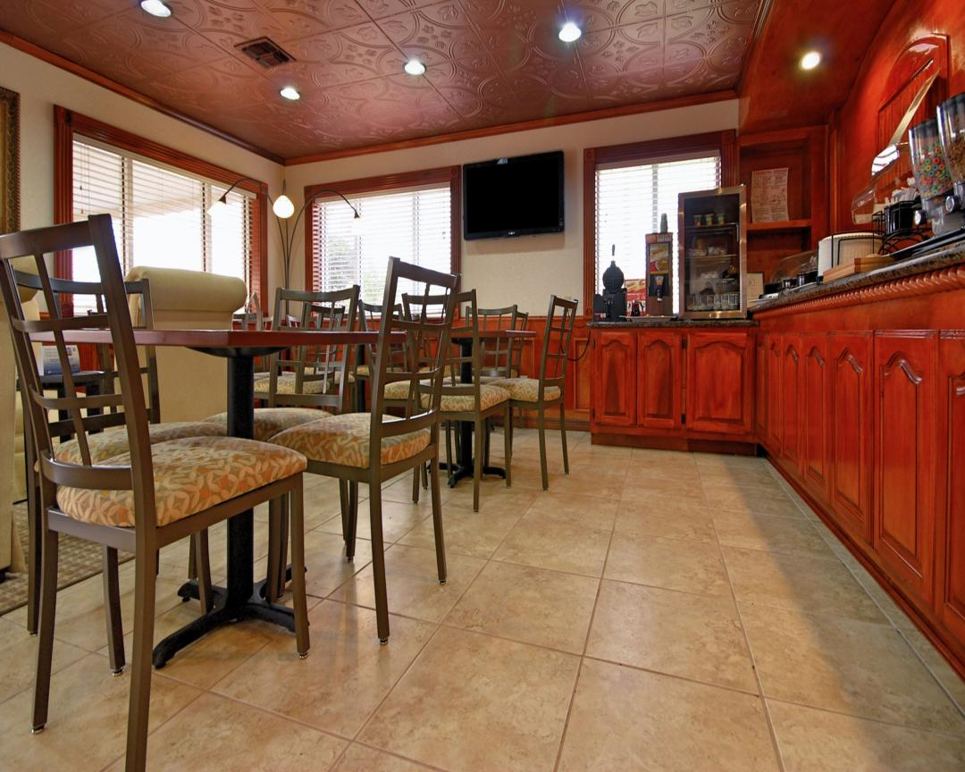 Breakfast Area with tables, chairs, and breakfast counter