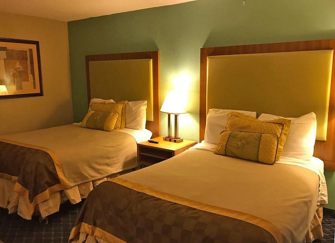 Two Double Beds with Warm Lighting