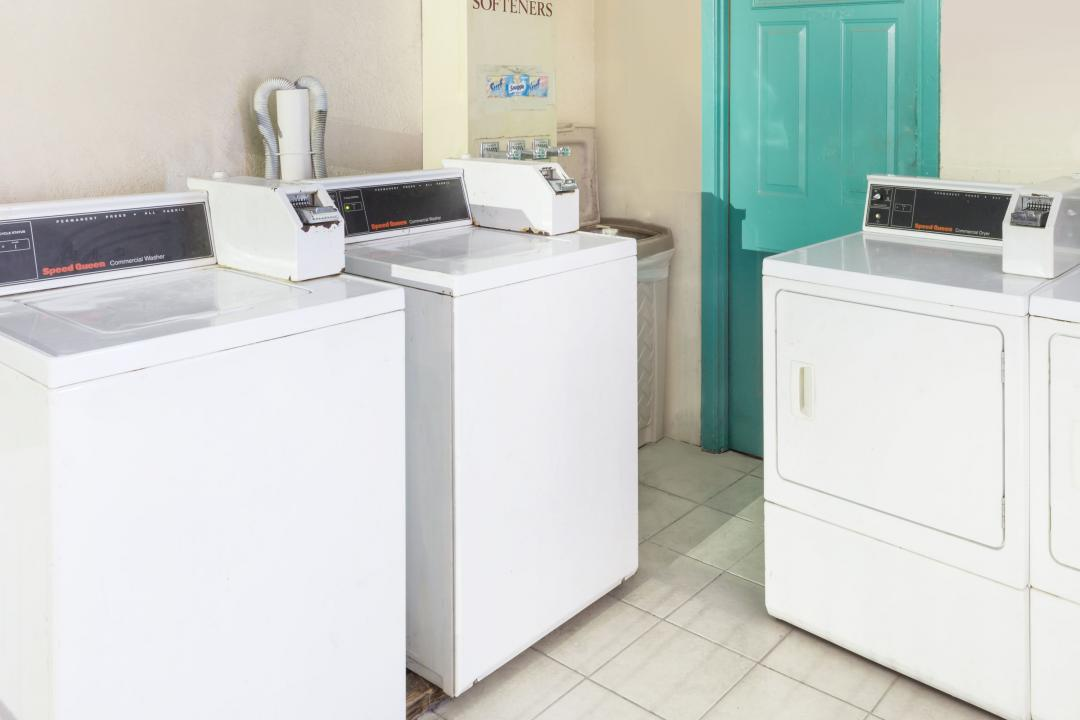 Visit our clean, well lit laundry room with 2 washers and 2 dryers.