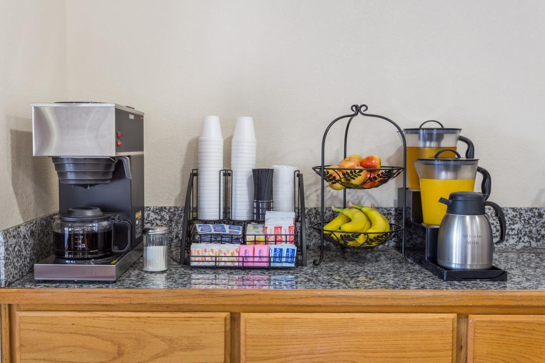 Complimentary breakfast includes coffee, fruit, yogurt, cereal and pastries