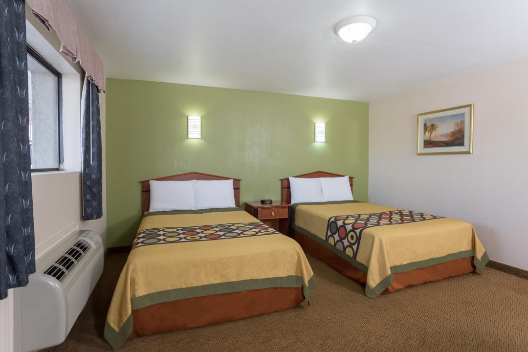Guestroom with two double beds and air conditioning