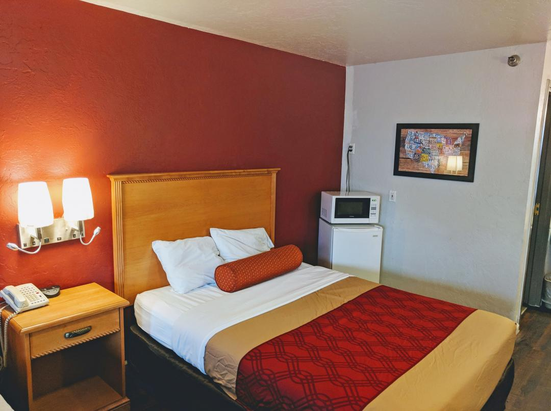 View of our Spacious One Queen Bed Suite with Amenities such as a Microwave and Micro Fridge.