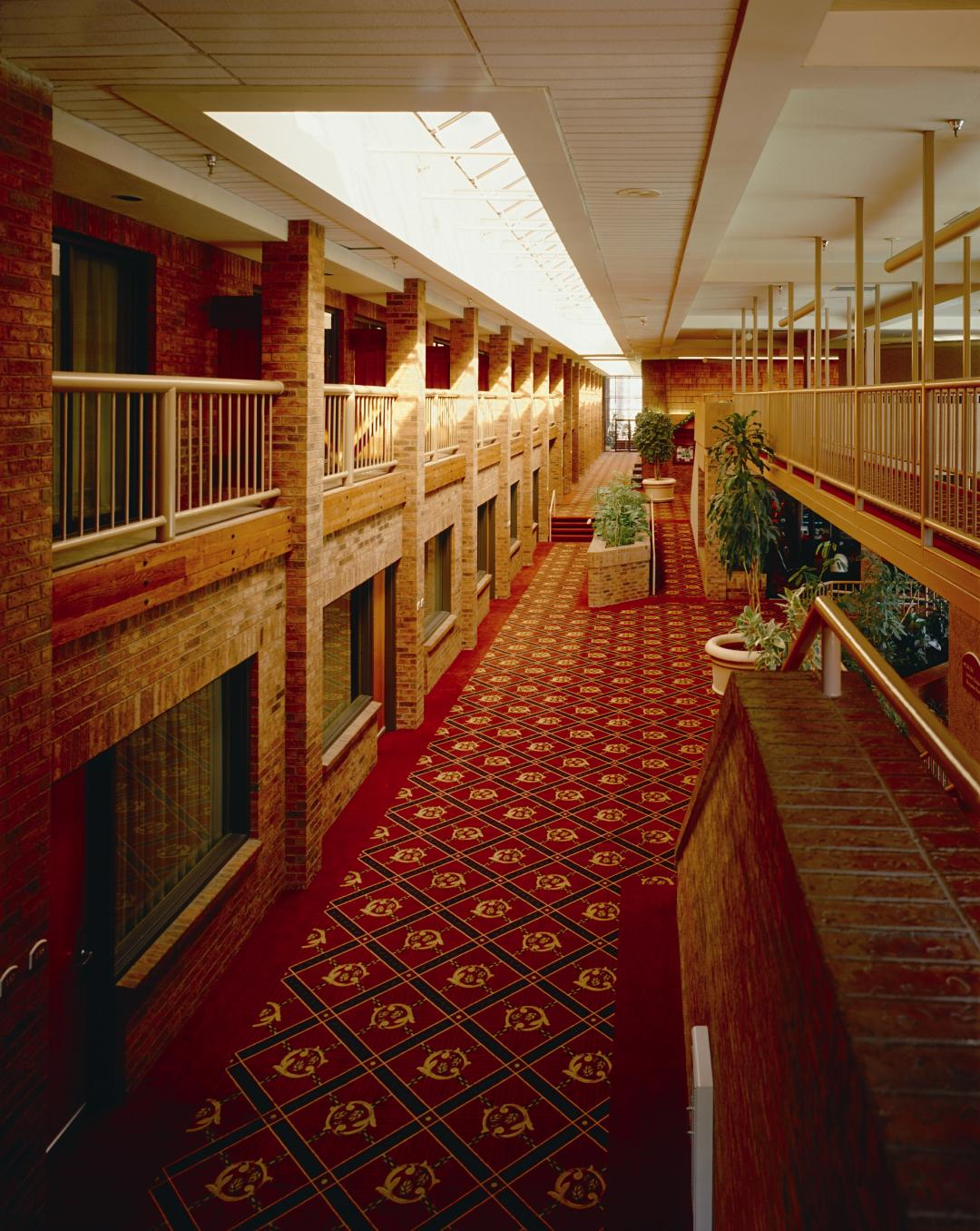 Red carpeted interior hallways