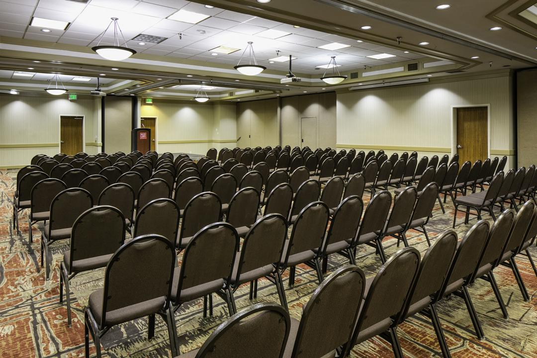 Spacious ballroom set for meeting
