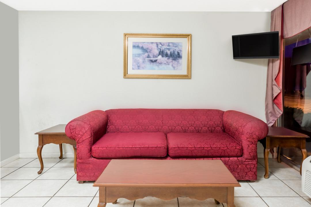 Guest seating area with sofa and tables
