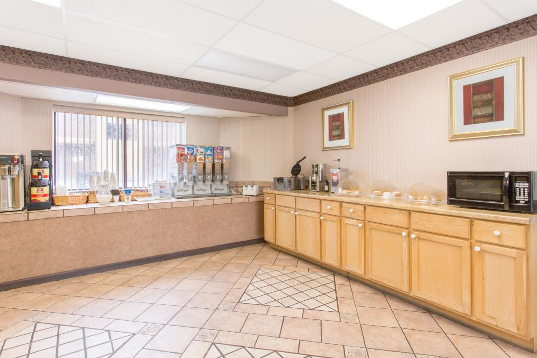 Enjoy complimentary continental breakfast featuring assorted cereals, waffle maker, and drinks.