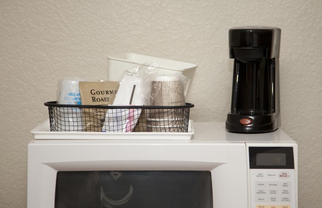 In-room coffeemaker, cups, ice bucket, gourmet roast, and microwave