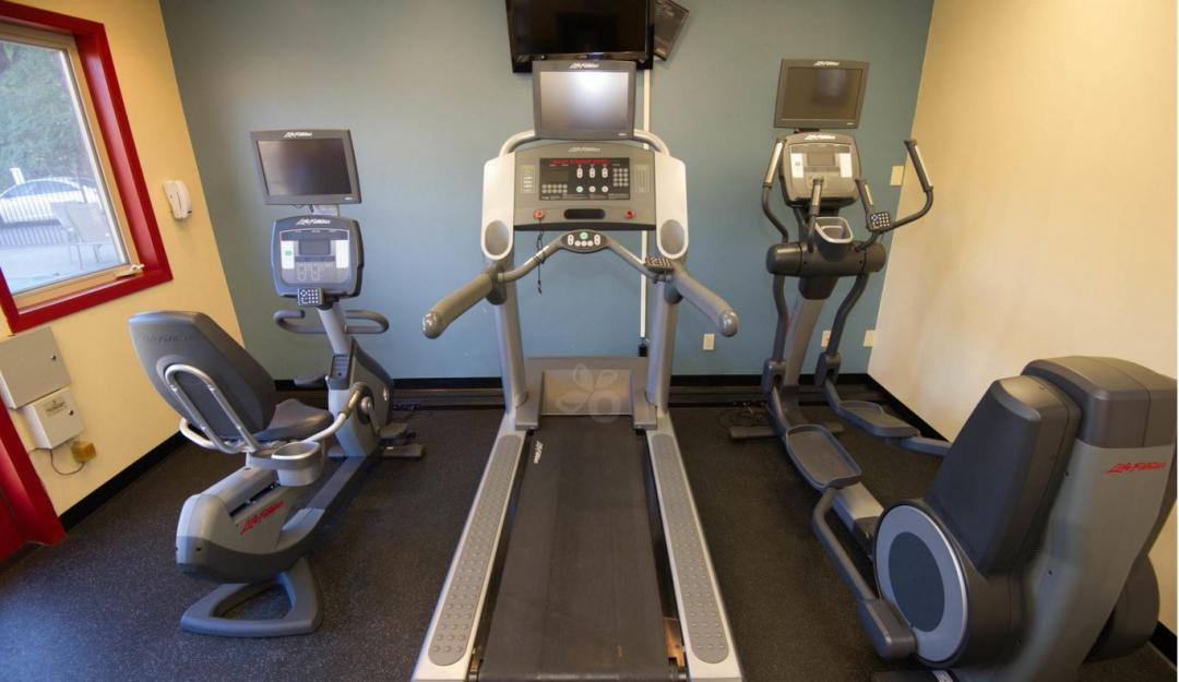 Fitness Facility with treadmills elliptical machine and stationary bike