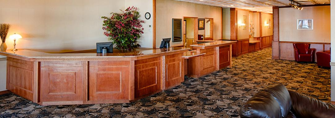 Large front desk with lobby seating