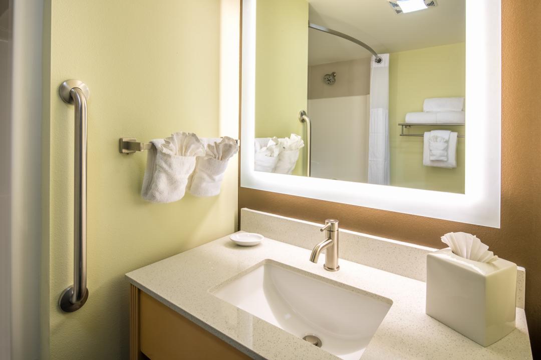 Clean, modern and well lit guestroom bathroom and vanity