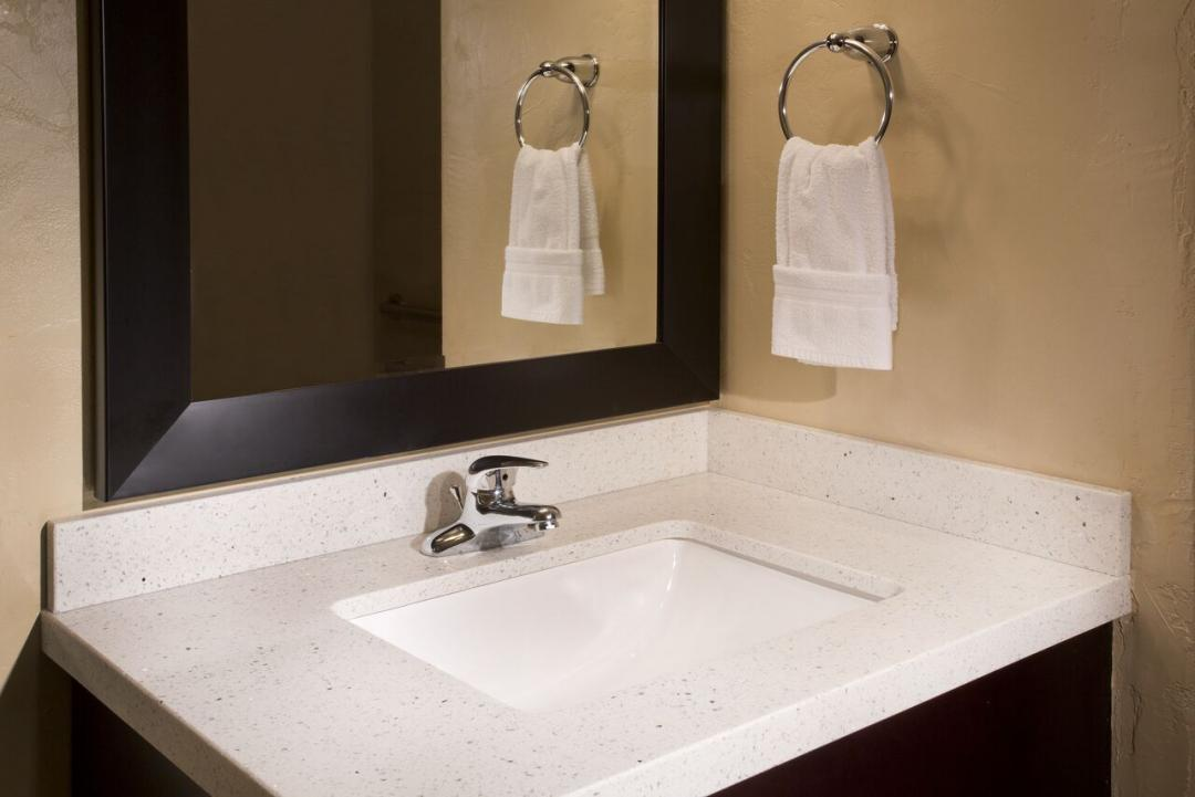 Clean, modern sink vanity with mirror