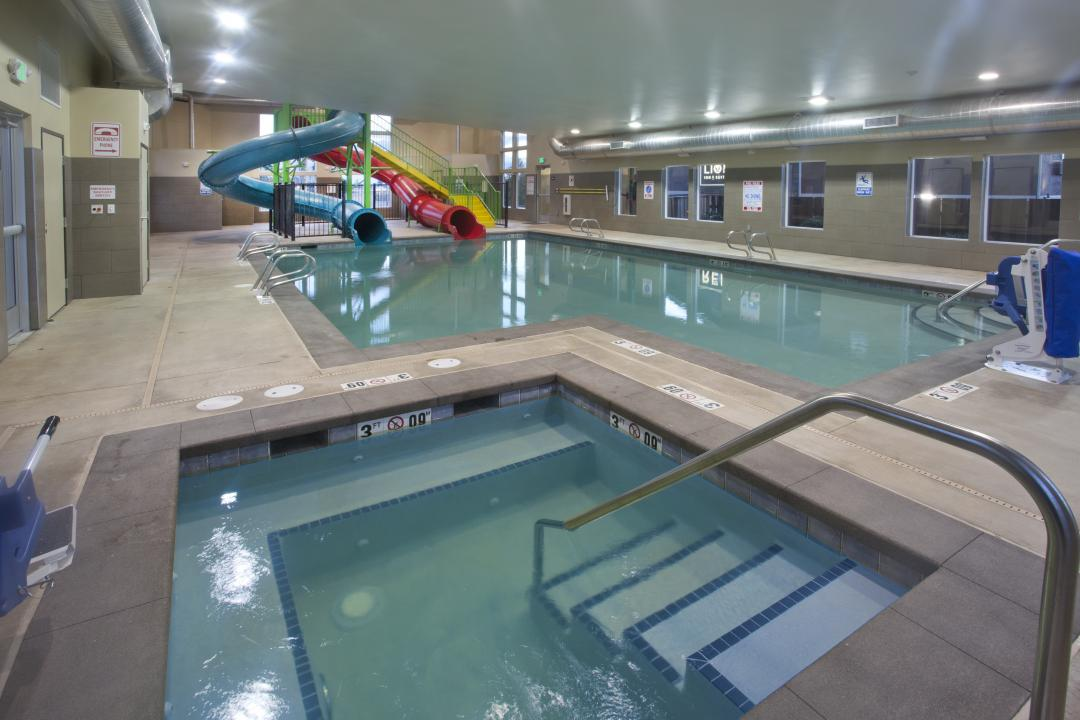 Indoor pool with slides and hot tub