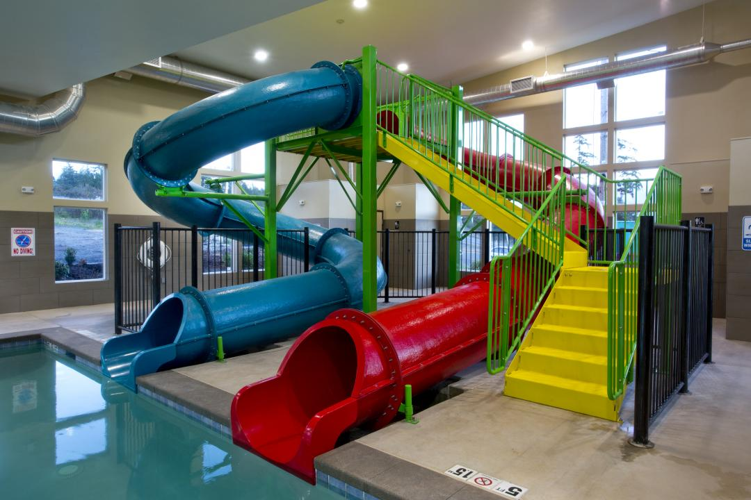 Two water park slides into indoor pool
