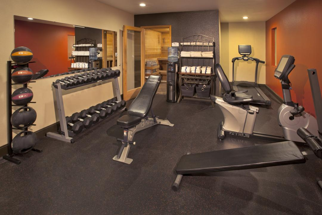 Fitness Facility with free weights stationary bike and weight benches