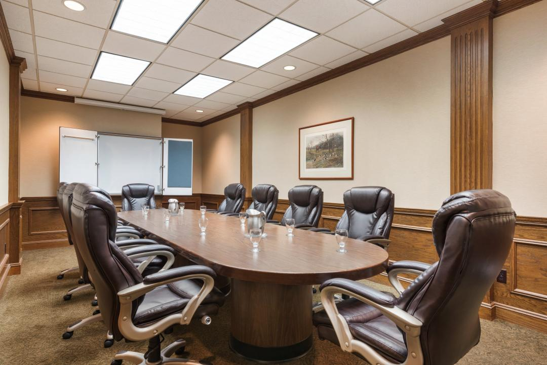 boardroom with tables and chairs