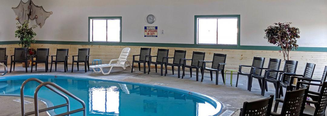 Indoor pool area with pool chairs