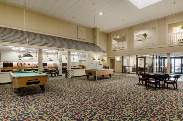 Lobby with seating and billiard tables